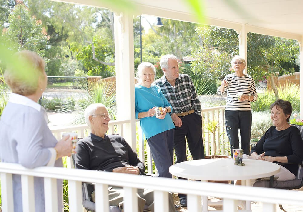 A group of retirees at St Ives Lesmurdie enjoying a cuppa on a verandah