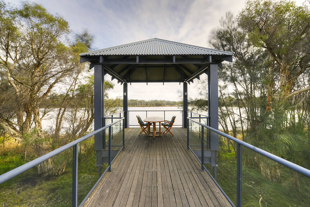Gazebo with picnic table overlooking water at St Ives Mandurah retirement village