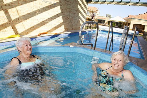 Two St Ives female residents enjoying heated spa at St Ives Northshore retirement village