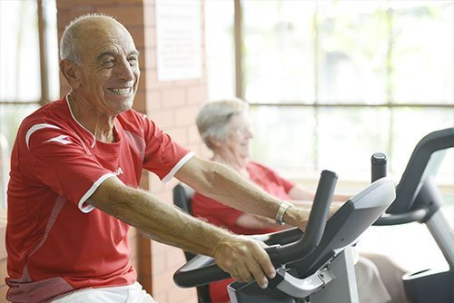 Retiree residents working out on gym equipment at St Ives Centro retirement village
