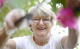 St Ives female resident pruning garden