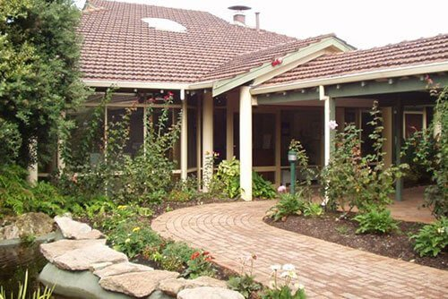 Villa with garden along pathway at St Ives Melville retirement village