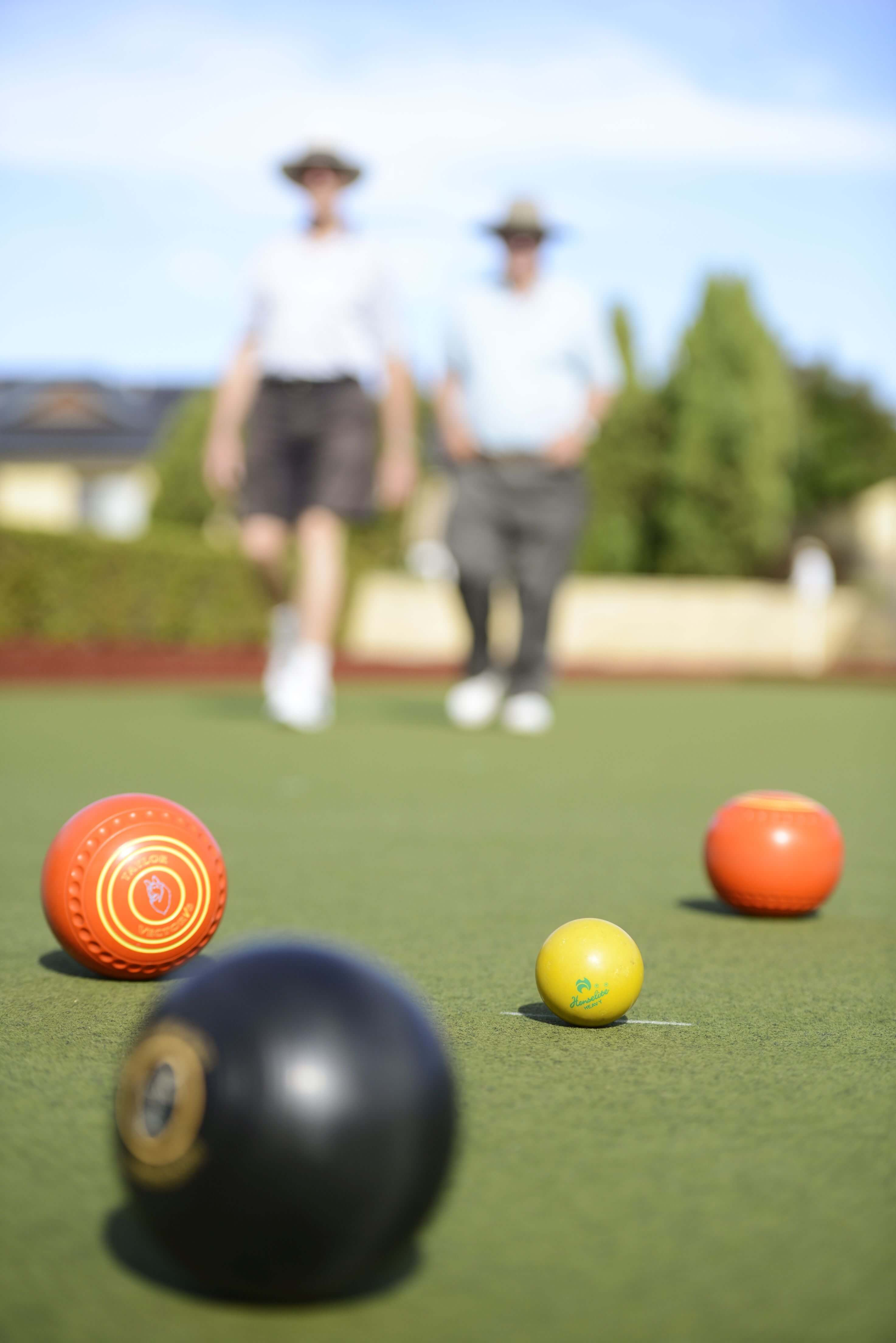 Artistic photo of a group of lawn bowls at a St Ives retirement village