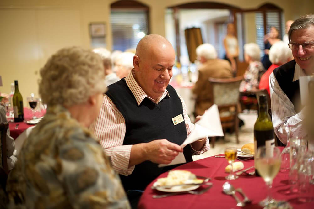 Residents socialising over dinner at St Ives Northshore retirement village