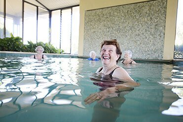 Group of female residents at St Ives enjoying water aerobics