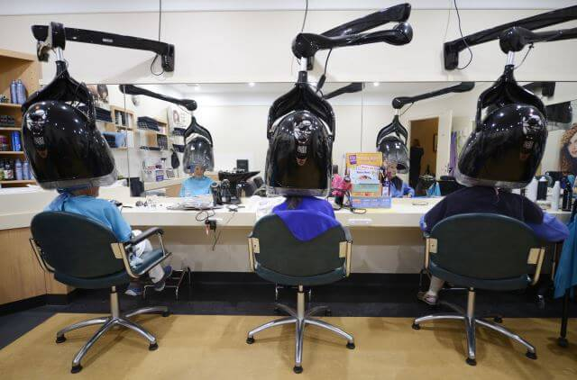 Three female retiree residents having their hair styled at St Ives onsite hairdressing salon