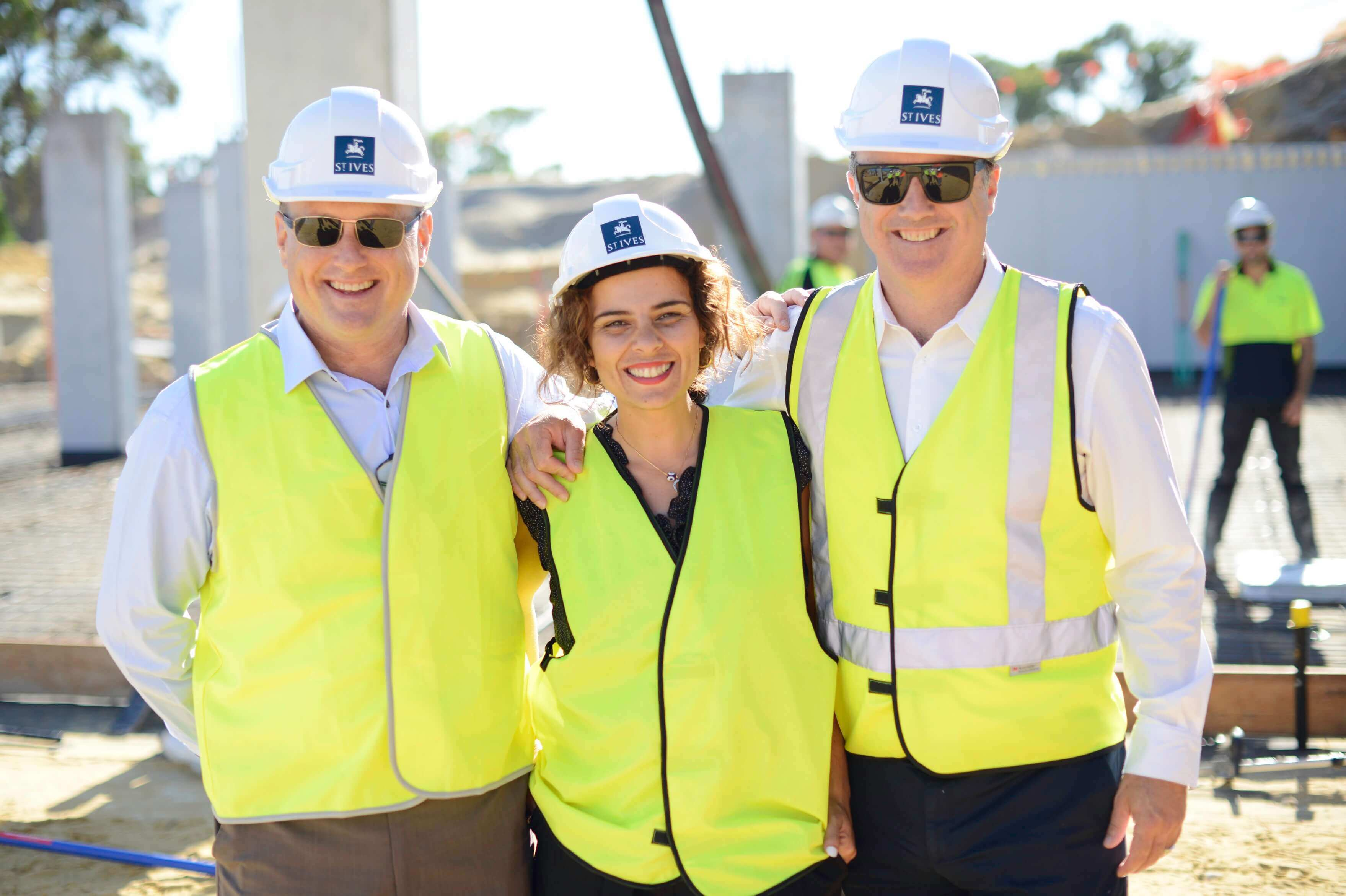 St Ives Retirement Living staff members dressed in fluorescent vests and hard hats on building site during construction of St Ives Carine village