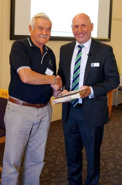 St Ives Murdoch retirement village Duty Officer, Mike receives an award from Executive General Manager, John Ford